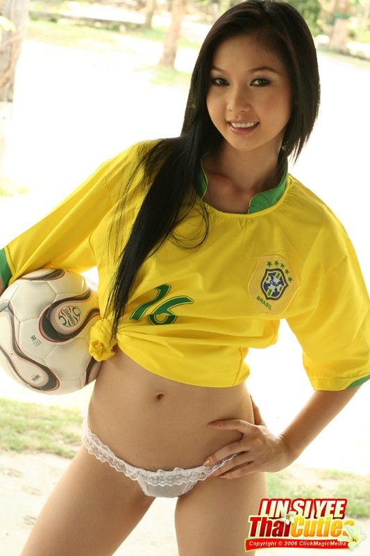 Asian girls playing soccer