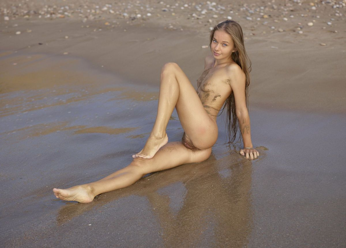 Stripping at the nude beach.