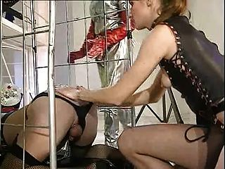 She inserts her foot finger in his asshole while strocking his big cock.