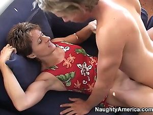 Mature women on bed having sex missonary position