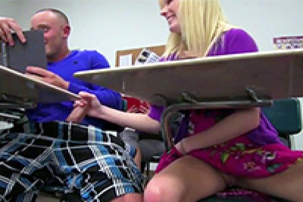 Girl giving a handjob in class