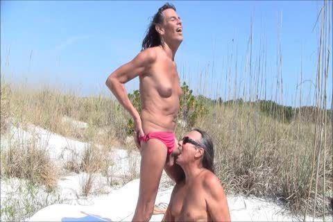 Hairy transgender suck penis on beach