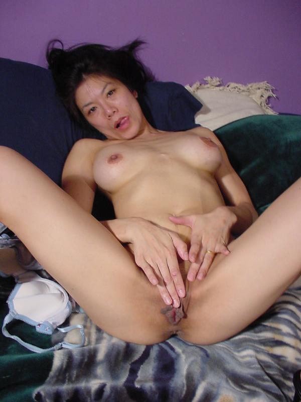 Horny asian masturbate