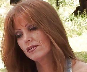 Mature redhead with powerful hands