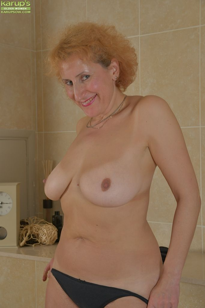 Shaved granny masturbating