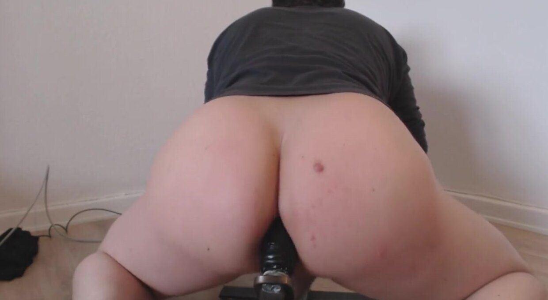 Taking dildo in ass
